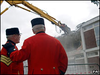 Chelsea Pensioners watch as the infirmary is demolished