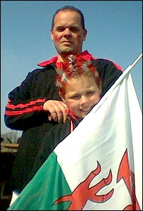 Father and son with Welsh flag