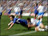Cedric Heymans is tackled into touch by the Italian cover