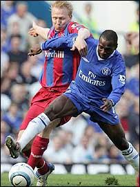 Aki Riihilahti, who scored Palace's equaliser, challenges Claude Makelele