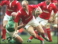 Wales centre Tom Shanklin takes on the Ireland defence