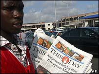A newspaper vendor outside of Lagos airport, Nigeria