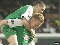 Jamie McCluskey congratulates goalscorer Derek Riordan