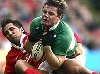 Ireland captain Brian O'Driscoll his tackled by Gavin Henson