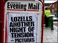 A newspaper billboard from Birmingham reporting the 2005 riots