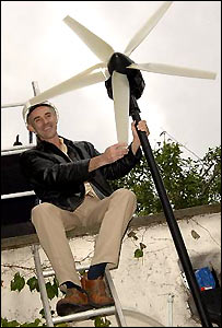 Donnachadh McCarthy and the wind turbine at his Peckham home