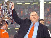 Wales coach Mike Ruddock holds the Six Nations trophy aloft