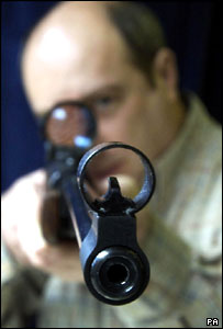 Shop owner Martin Morris holds a Webley fully legal power air rifle