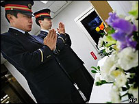 Tokyo subway workers pray on the 10th anniversary of 1995's sarin attack