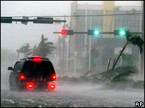 A van passes through flooding in downtown Naples