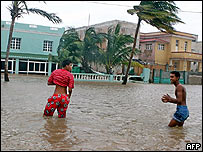 People wading through flood waters in Havana