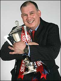 Mike Ruddock celebrates with the RBS Six Nations trophy