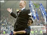 Rangers manager Alex McLeish is held aloft by striker Nacho Novo