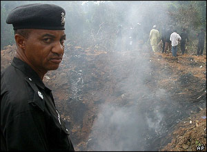 Policeman stands net to the crater