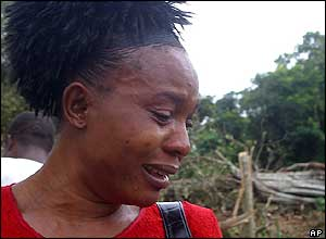 Woman crying after visiting the crash scene.