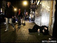 Reveller lying in street