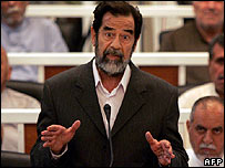 Saddam faces the court on the first day of his trial