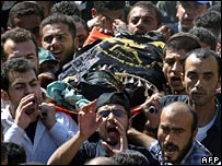 Palestinians carry the body of Luay Saadi during his funeral in the northern West Bank