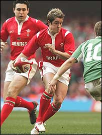 Wales wing Shane Williams takes on the Ireland defence 