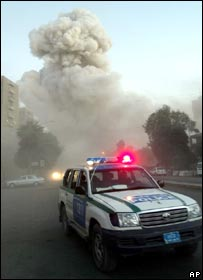 An Iraqi police car rushes along the street as a huge explosion rattles central Baghdad