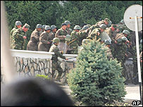 Soldiers flee from the administration building which later was captured by protesters in Osh - 21/3//05