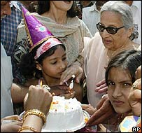 Zarin Musharraf cuts a cake in Delhi, where the president spent his childhood