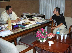 Khalil Merroun with faithful in his office
