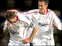 Steven Gerrard is congratulated by Liverpool team-mate Peter Crouch
