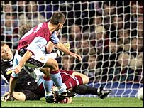Aston Villa striker Kevin Phillips scores against Burnley