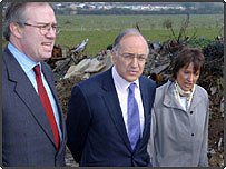 Conservative Leader Michael Howard, MP Caroline Spellman and local MP John Baron view a travellers' site from a neighbouring property at Greys Hill, Essex