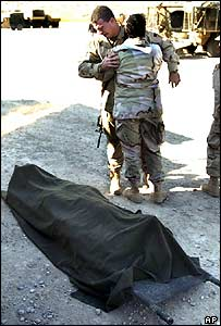 US soldier weeps near body of comrade killed in a mortar attack near Mosul in December 2004