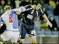 Andy Todd tustles with Robbie Blake during the Carling Cup tie