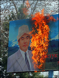 Portrait of Askar Akayev burnt