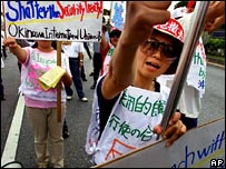 File photograph of Okinawa residents protesting against the US base at Futenma