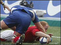 Martyn Williams tunnels under the France defence to put Wales into the lead