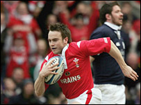 Scott Murray looks upwards in despair as  Wales wing Rhys Williams intercepts for a try