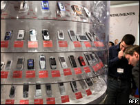 Phones on display at Cebit show, AFP/Getty