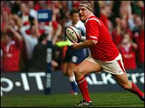 Gethin Jenkins races away in celebration after scoring the opening try against Ireland