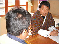 Dr Chencho Dorji and Gopal (with his back to the camera)
