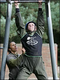 Kelly Holmes helps our man on the assault course