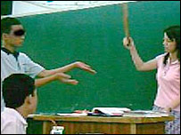 A pupil being caned by his teacher in Taiwan (October 2005)