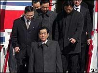 North Korean Premier Pak Pong-ju (centre) arrives at Beijing airport