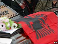 Coffins of victims found in mass graves