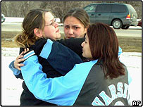 Red Lake High School students Sondra Hegstrom, Marla Hegstrom and Ashley Morrison weep together following a deadly shooting rampage