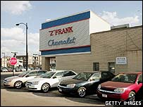 New Chevrolet cars stand on display in front of a dealership March 16, 2005 in Chicago