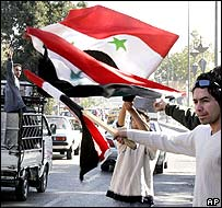 Syrians demonstrate against the UN report in Damascus