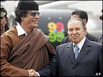 Libyan leader Colonel Muammar Gaddafi (left)  and Algerian President Abdelaziz Bouteflika