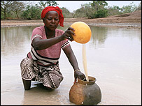 Woman getting water in Africa [courtesy of WaterAid]