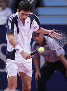 Henman looks out of sorts as he sizes up a return at the St Jakobhalle Arena