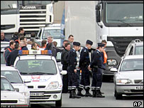 Striking ferry workers block the road in France on Monday